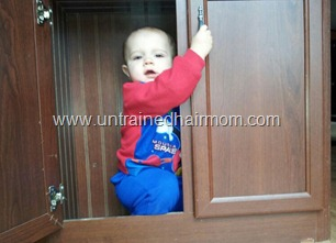 baby in cabinet