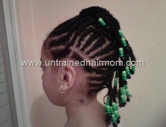 cornrow faux hawk mohawk style with beads